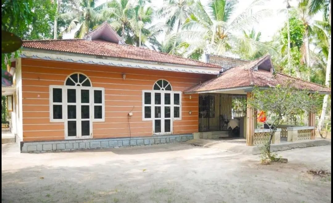 21 Cent Residential Land with House. 150m from NH 66. Serene Locale.